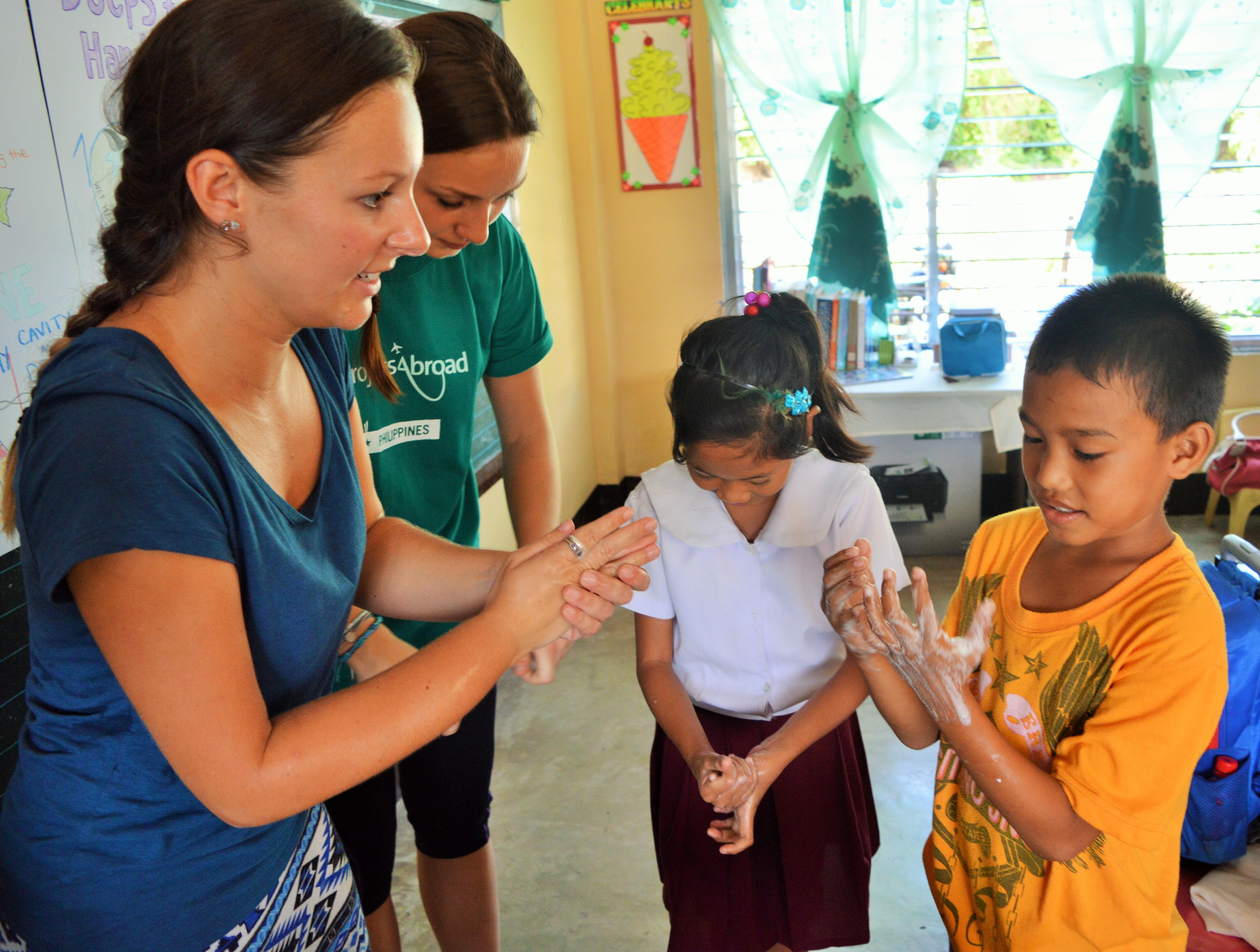 Volunteers run a hygiene class for their students during their teaching work experience in the Philippines